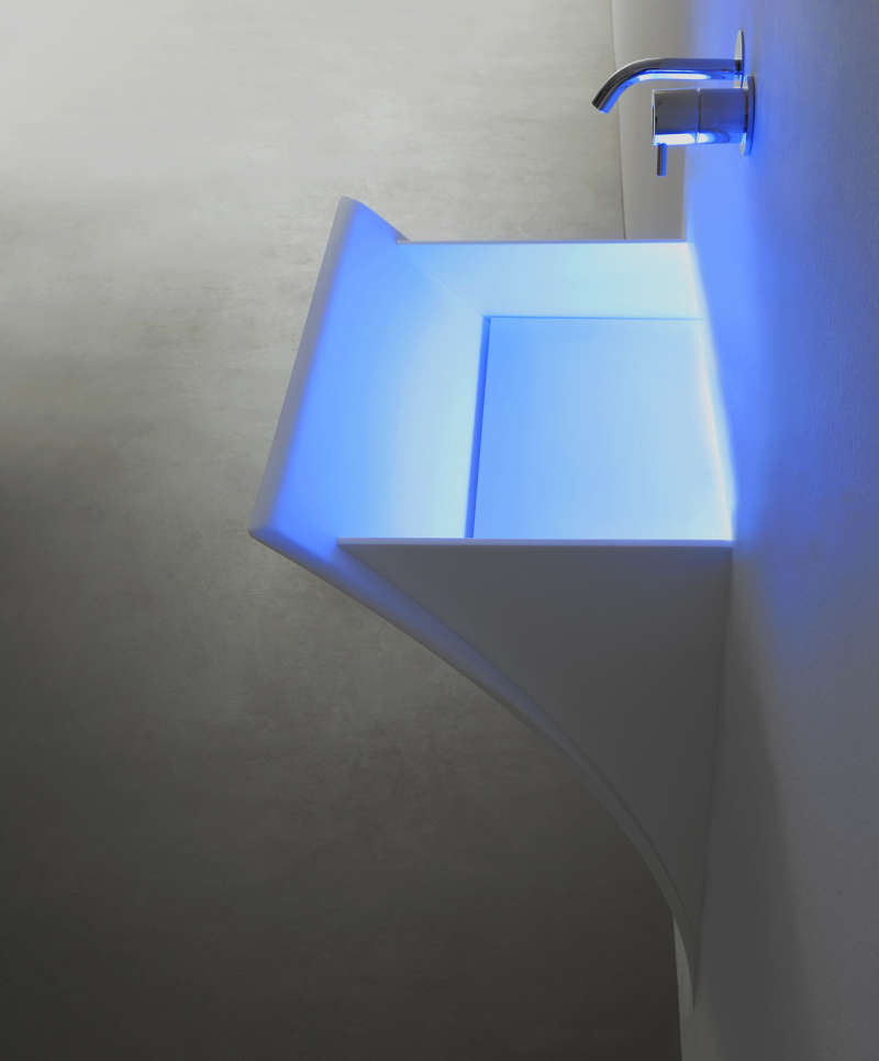 Wall hung sink lit by LED lights