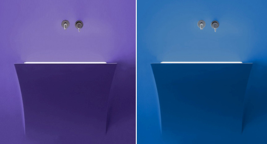 Bathroom sinks that are finished with same color and paint as the wall.