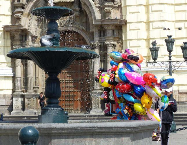 Balloon vendor waiting for customers outside church