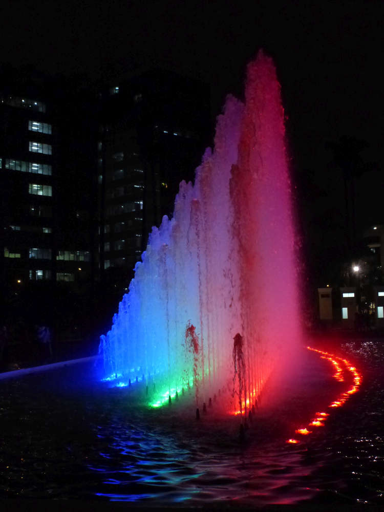 A water fountain in all the colors of the rainbow.