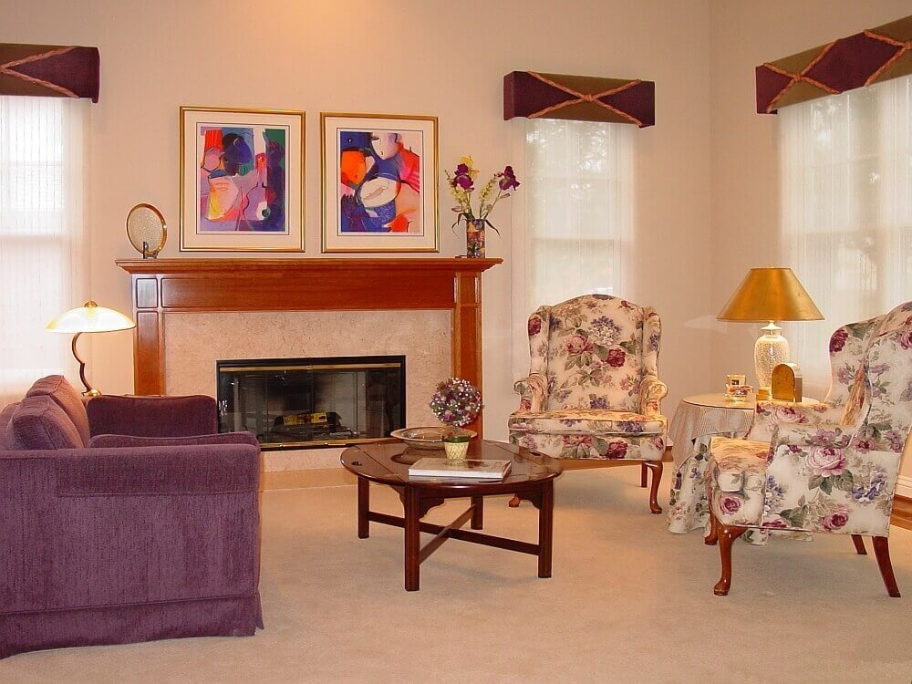The formal living room is dressed up by the custom cornice boxes and sheer Roman shades.