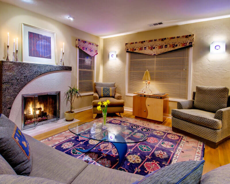 InterSpace Design - Granite Fireplace Surround and Wood Custom Cabinet in Living Room