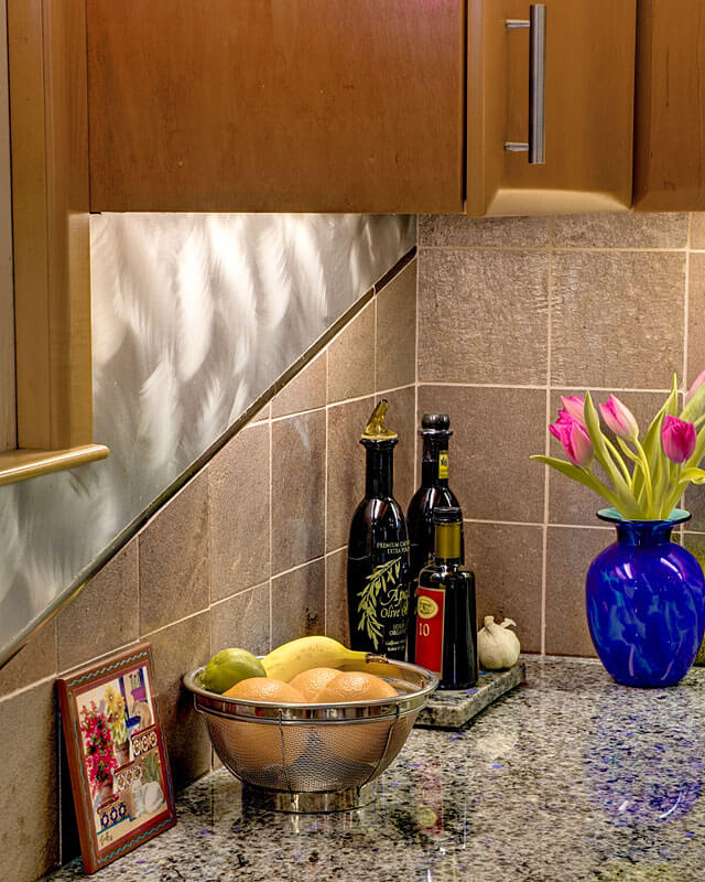 InterSpace Design - Kitchen Remodel with close-up of Stainless Steel and Slate Backsplash