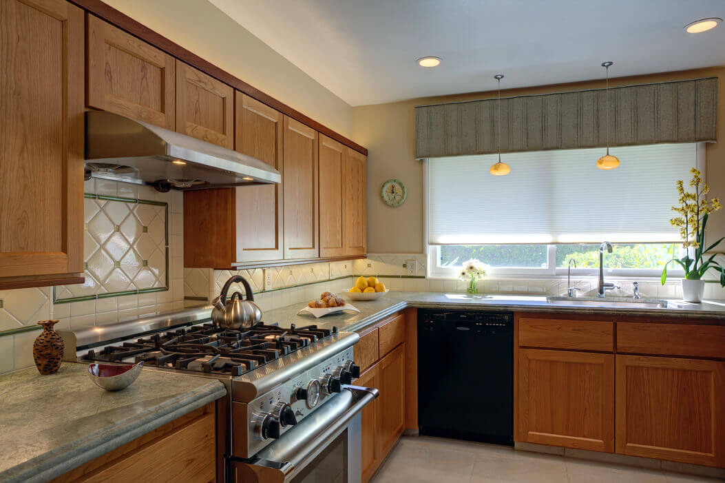 Renovated Sunnyvale kitchen with energy efficient lighting, custom designed cabinets,counters and floors